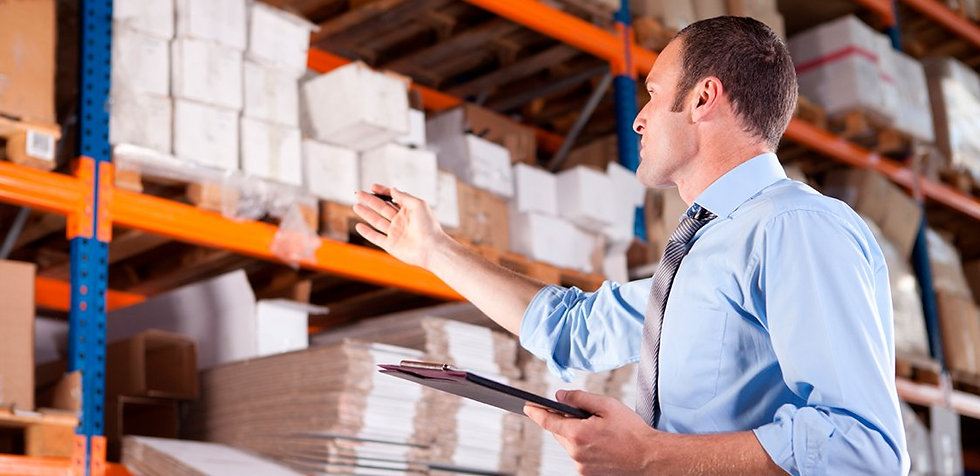 Inventory Control Worker Counts Materials in Warehouse