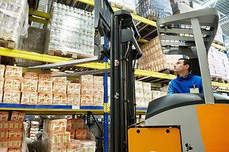 Food Warehouse Worker on Forklift
