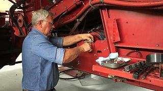 Technician Repairs Tractor