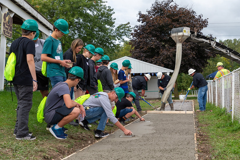 Students Help Build a Cement Sidewalk