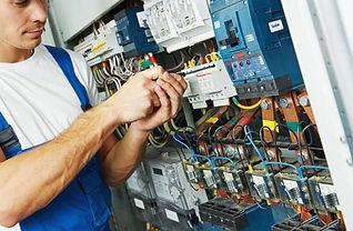 Electrician Wiring a Machine