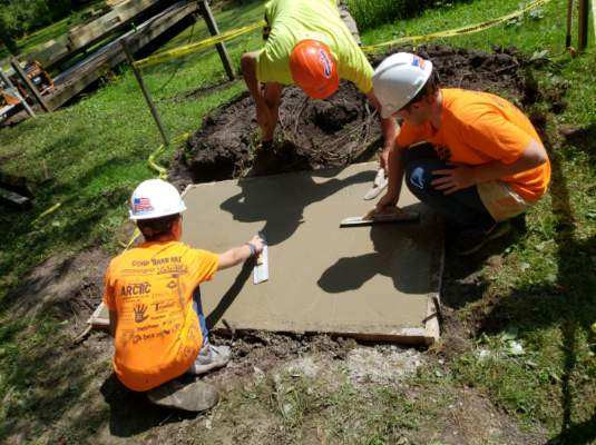 Camp Hard Hat - Leveling cement at the Genesee County Park in East Bethany