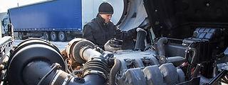 Diesel Mechanic Fixing Truck