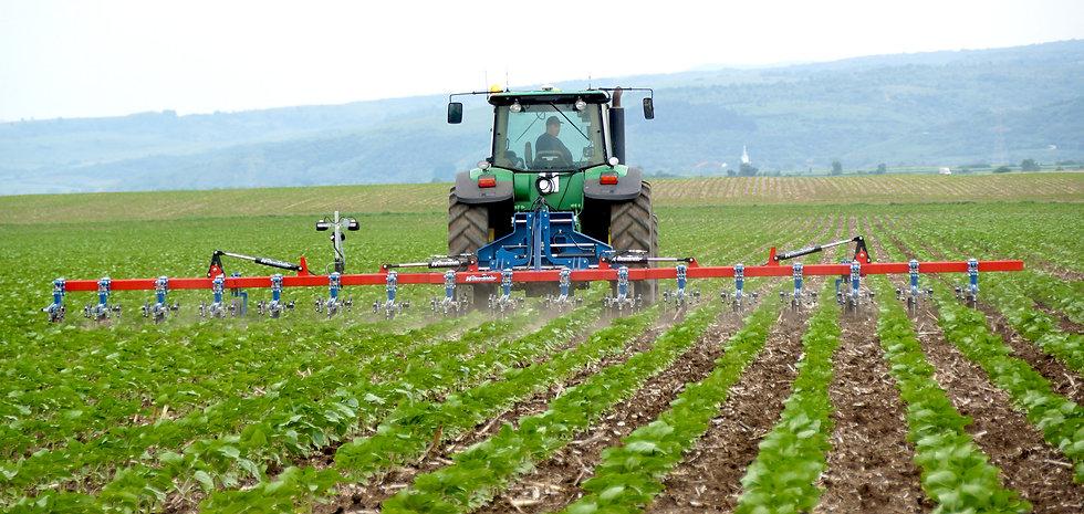 Farmer on Tractor Plowing Field