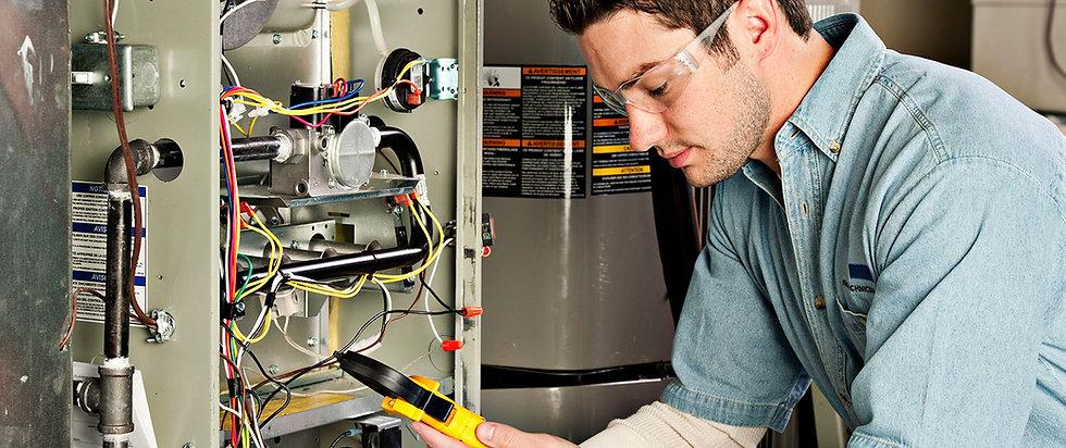 HVAC Technician Fixing Heating Unit