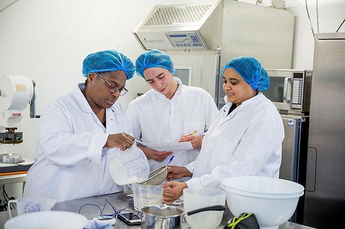 Food Quality Control Lab Technicians Testing Food in a Laboratory