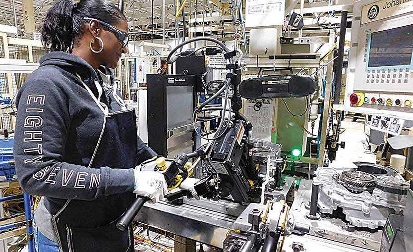 Factory Worker Assembling Parts