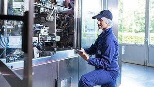 Maintenance Repair Technician working on machine