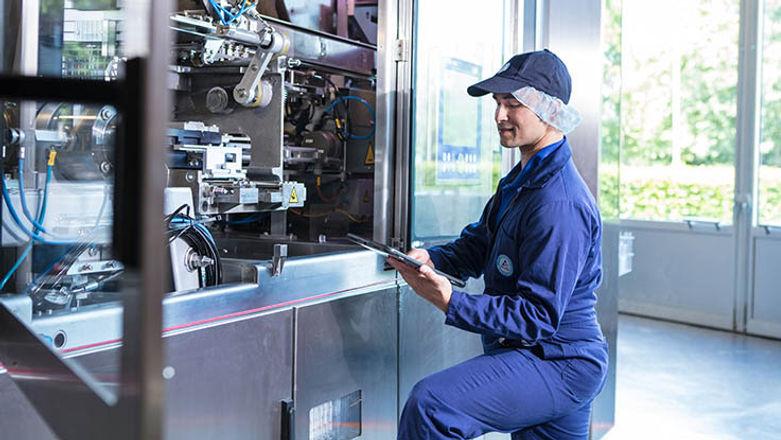 Maintenance Repair Technician Works on Machine
