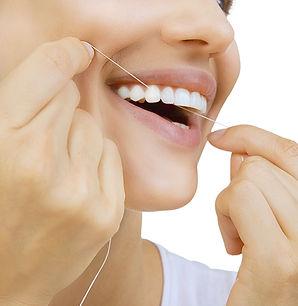 Zahnreinigung mit Zahnseide