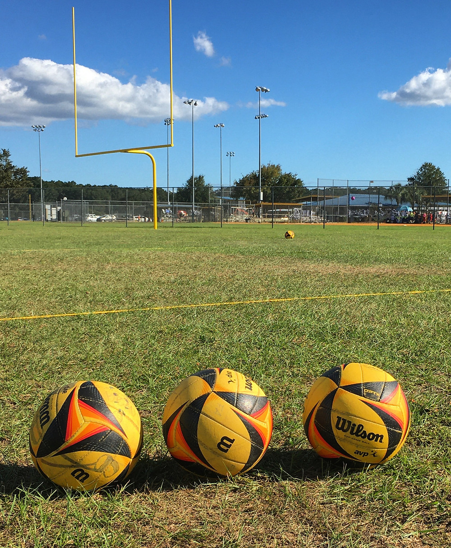 AVP Optx volleyballs on grass