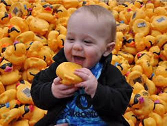 Baby with ducks.png