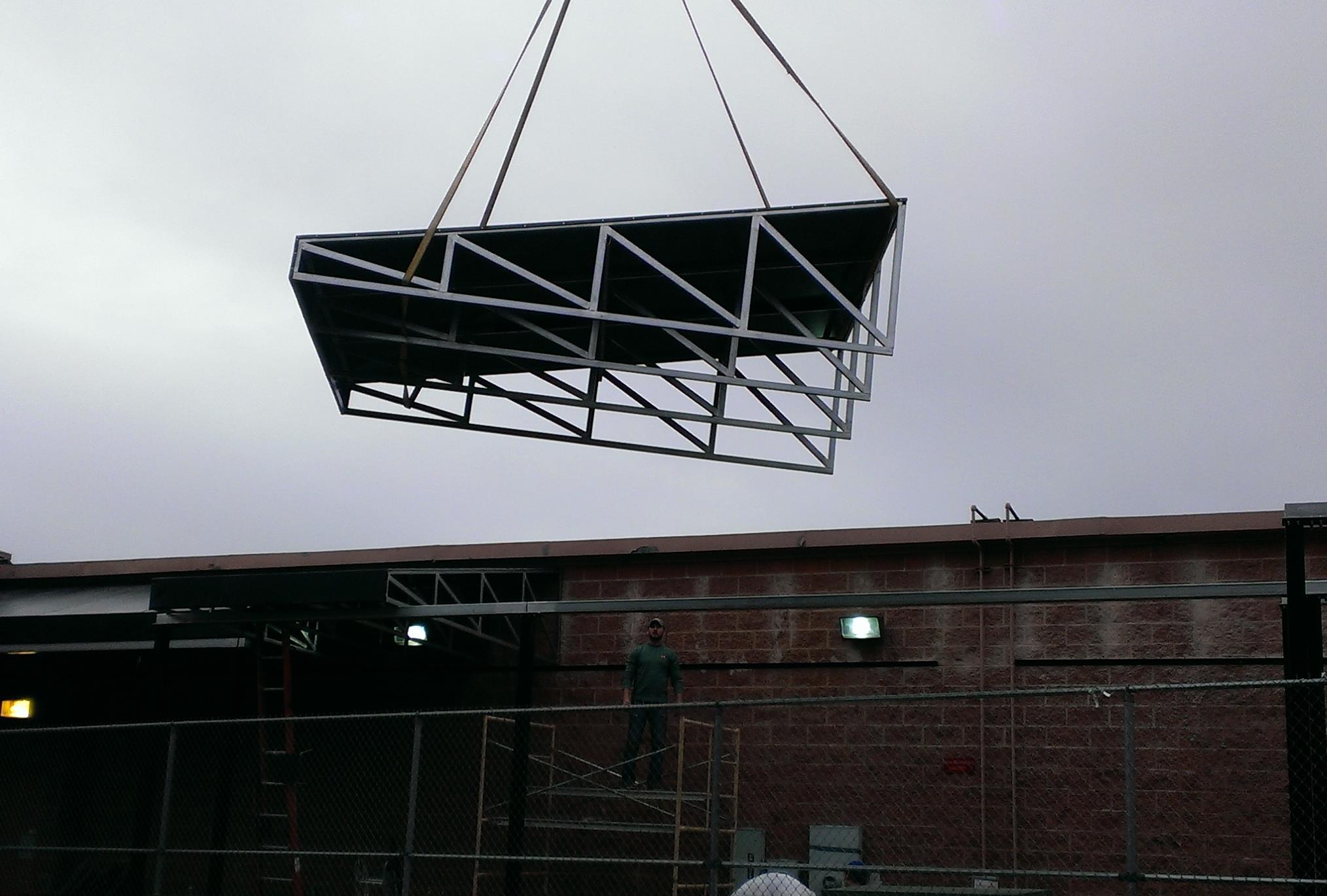 Lifting Trader Joe's awning parts