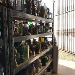 Various glass bottles green centerpieces