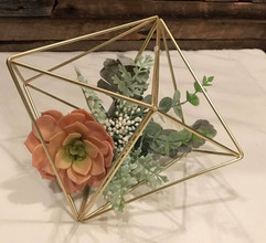 various shaped centerpieces in gold meta