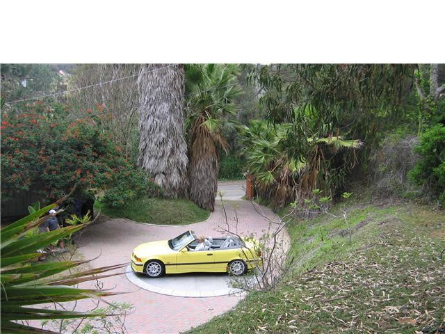 BMW convertable , driveway, 5 year old m