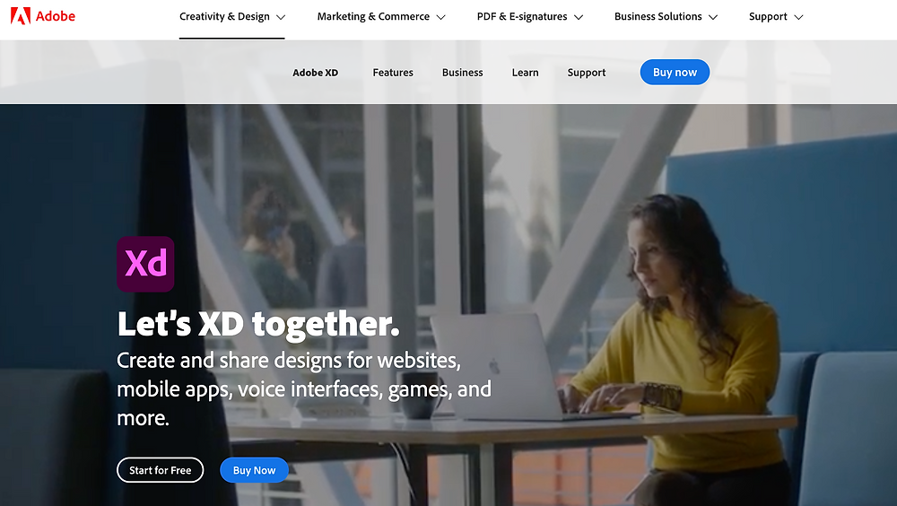 """A screenshot of the Adobe Xd homepage. The headline reads """"Let's XD together. Create and share designs for websites, mobile apps, voice interfaces, games, and more."""" The header image shows a woman on her laptop at a coffee table."""