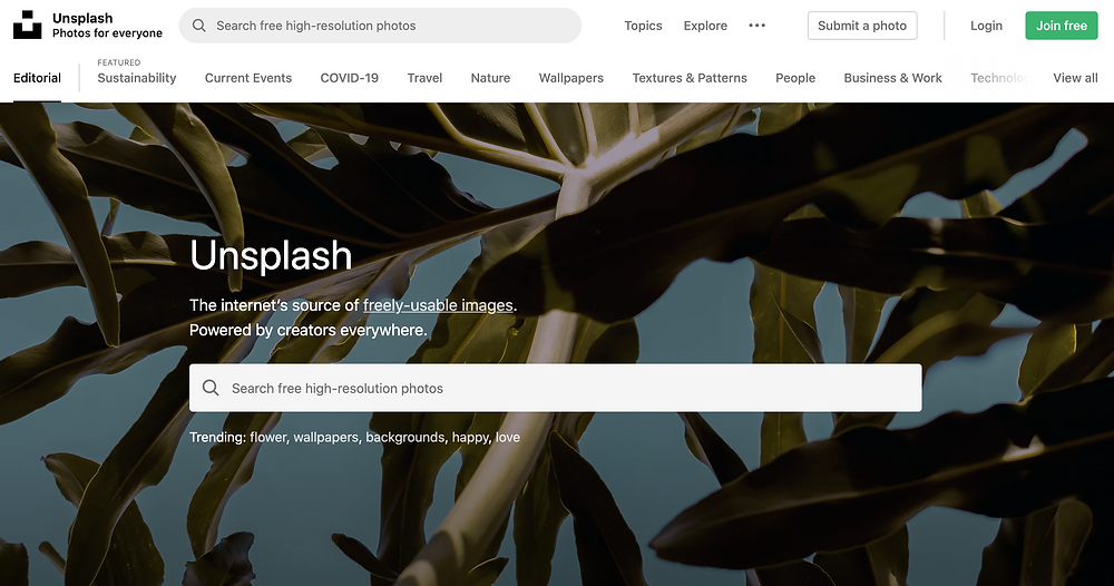A screenshot of the Unsplash website's homepage which shows the photo categories at the top navigation bar and a big search bar in the center. Unsplash | The internet's source of freely-usable images.