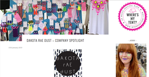 screen grab of an article about dakota rae dust on Where's my tent? blog.  the featured image shows many pairs of colourful earrings displayed on a bright blue peg board.