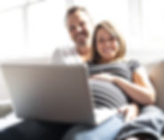 couple on laptop looking at camera cropp