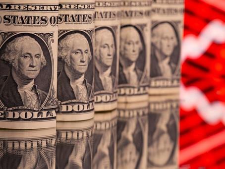 Dollar trades near two-week low as U.S. yields fall