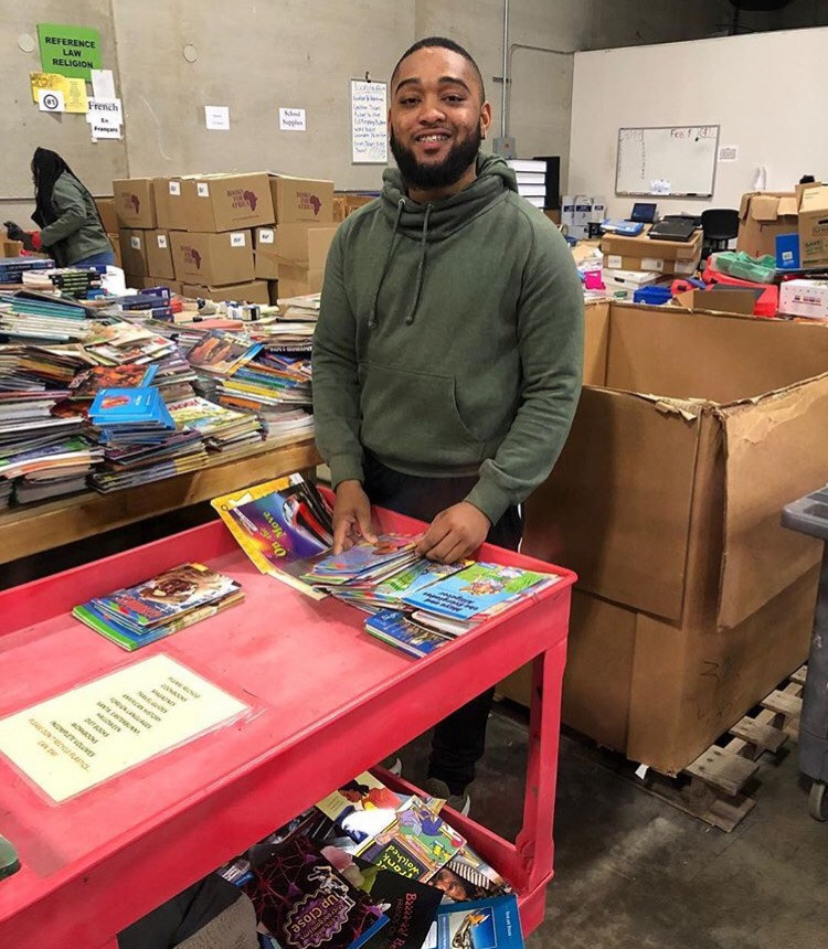 Brother Folkes volunteers at Books for Africa