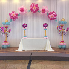 Carnival Balloon columns with flower balloon arch