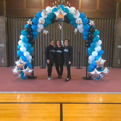 Classic Spiral balloon arch with silver star accents