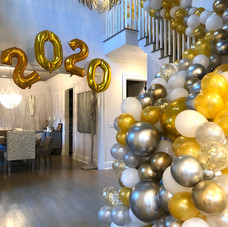 Staircase cascading balloons