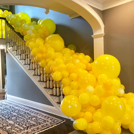 Organic yellow stair case balloon cascade