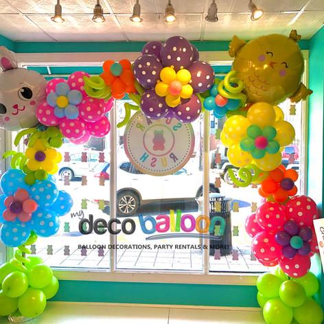 East themed balloon flower arch