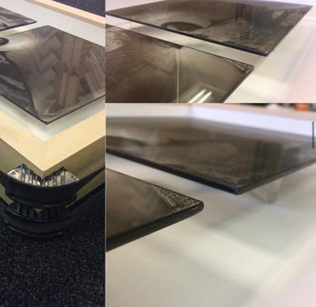 floating glass plates within box frame