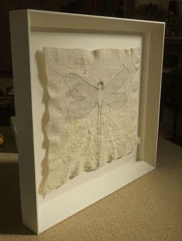 floated work in felt within bevelled box frame