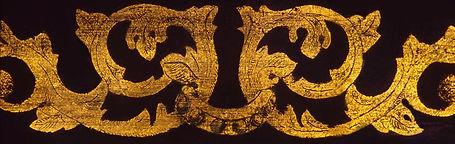Deatil of gilt scrolling acanthus leaves.