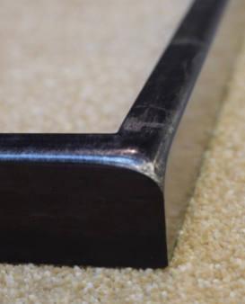 gilded sloping corner frame