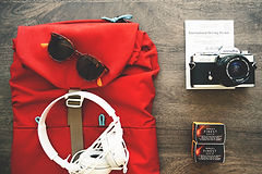camera backpack sunglasses