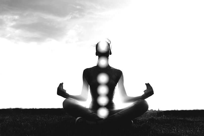 Woman%20practicing%20meditation%20in%20sunset%2C%20with%20chakras%20marked_edited.jpg