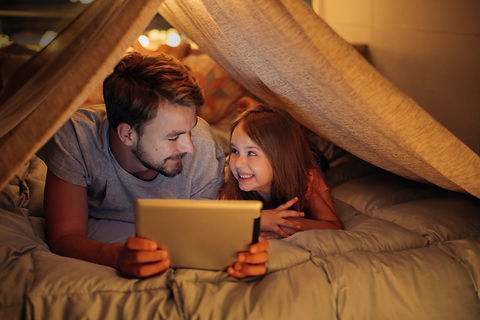 Father-and-daughter-enjoying-at-home-000