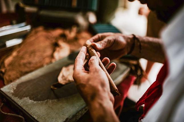 hands-of-craftsperson-making-cigar-leave