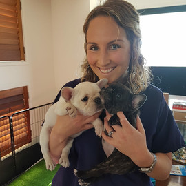 One of our wonderful vets Dr Lucy having cuddles after vaccinating the puppies at our home