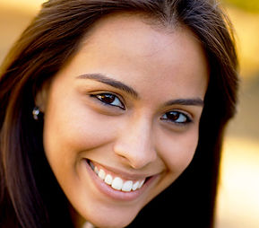 woman tilting head to left and smiling