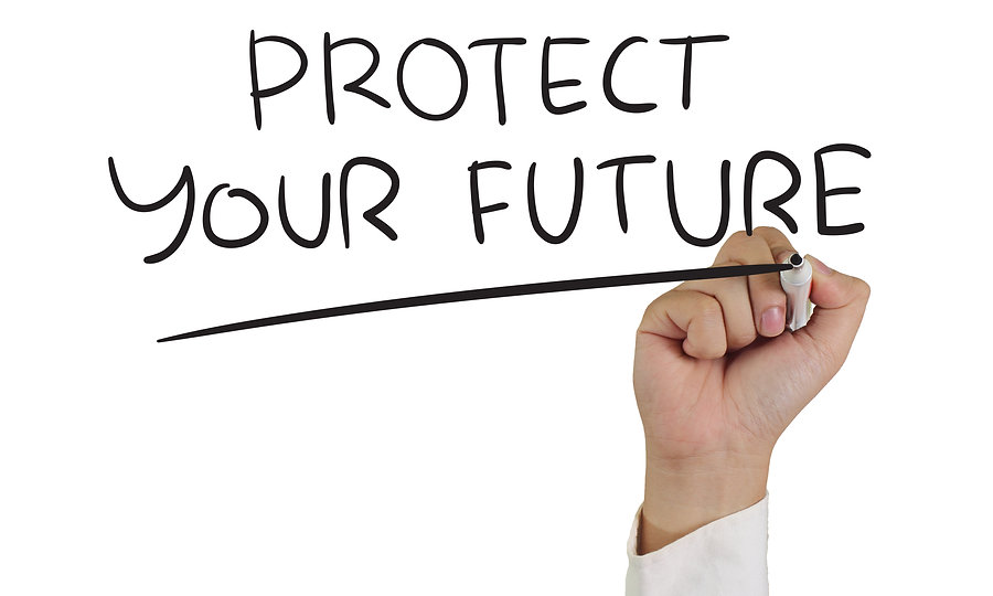Business concept image of a hand holding marker and write Protect Your Future isolated on