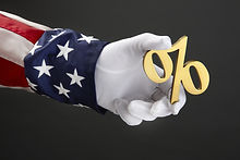 close up shot of Uncle Sam holding a percent symbol.jpg