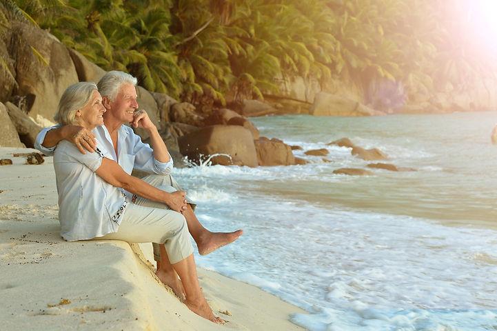 couple  relaxing on  tropical beach.jpg