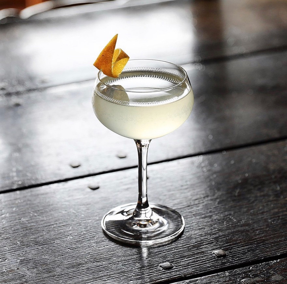 20th century cocktail garnished with a lemon twist, cocktail recipes with gin, 20th century cocktail history, classic cocktails, best gin cocktails