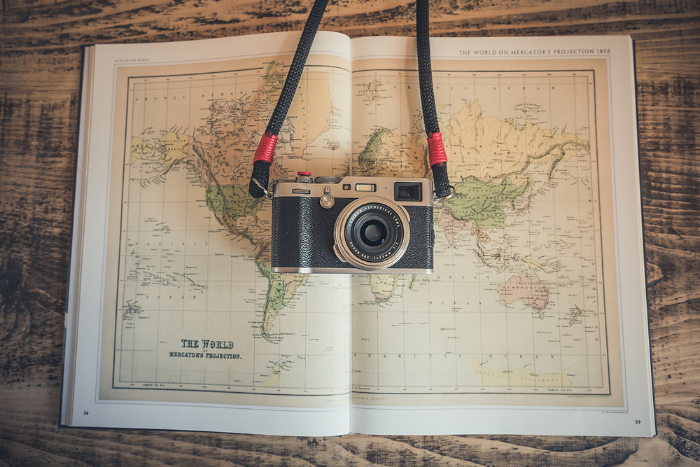 holiday gift guide for travelers, what to buy the travel addict in your life, gift ideas for the traveler, parched around the world