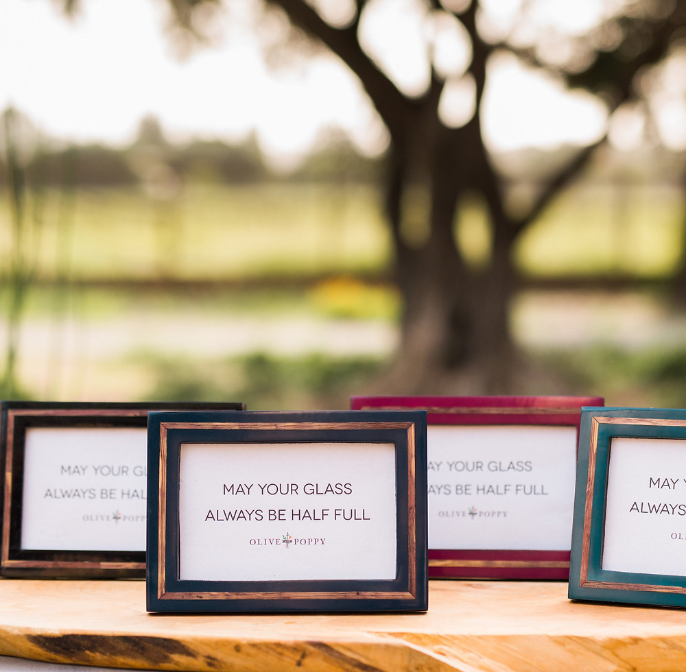 Picture frames made from reclaimed oak wine barrels that come in six different colors, olive and poppy