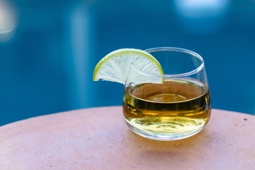 the difference between reposado blanco and anejo tequila, espolon, casamigos, blue nectar, espanita, glass of tequila straight garnished with a lime wedge, drinks to make with tequila