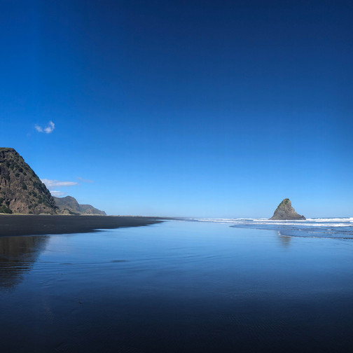 panoramic view of karekare beach in north island new zealand on a sunny winter day