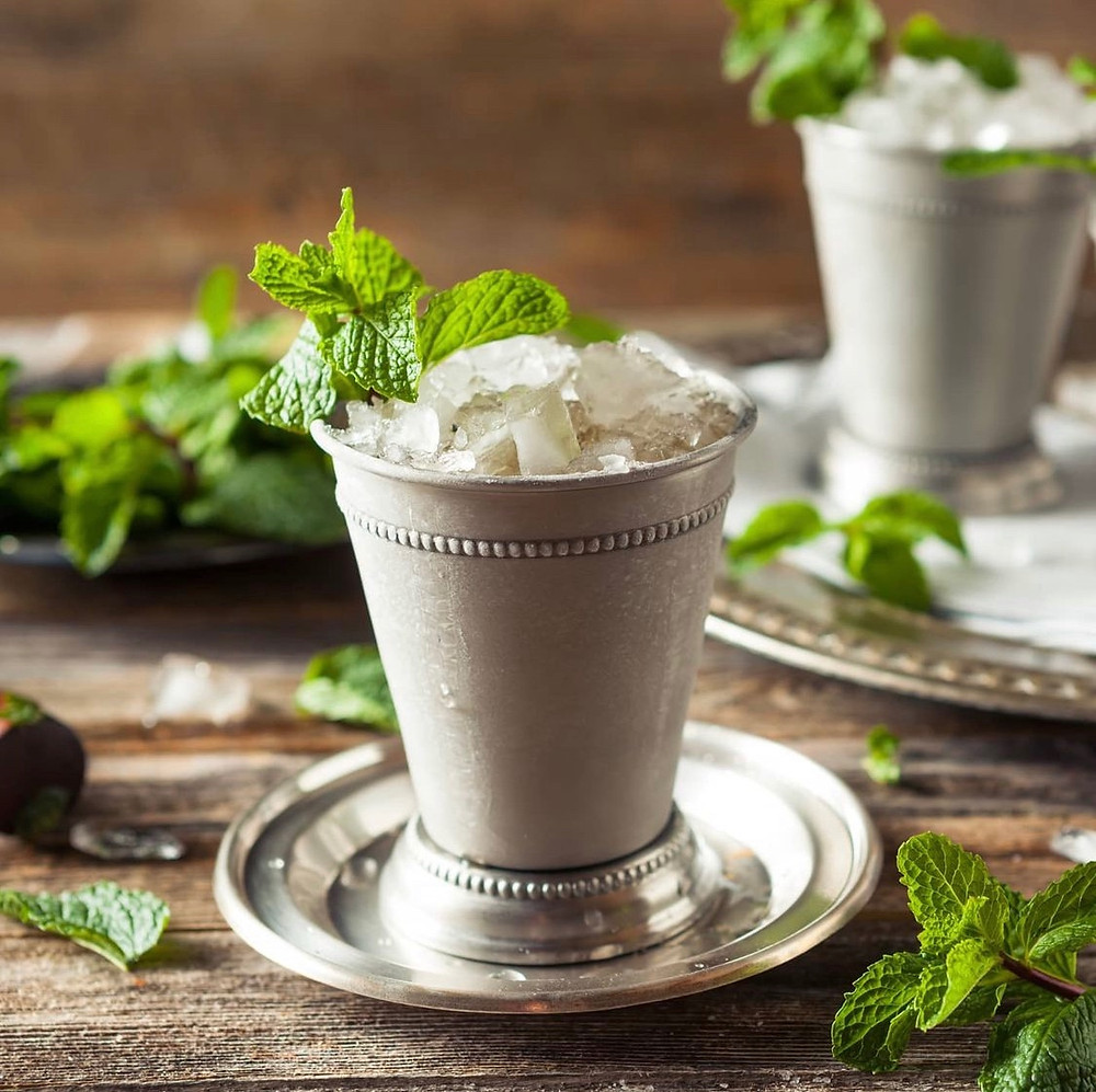 Mint julep in a cold tin cup garnished with mint, cocktail recipes, Kentucky derby cocktail recipes, mint julep ingredients, how to make a mint julep
